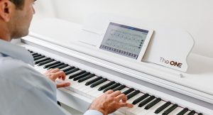 Keyboard that teaches you to play